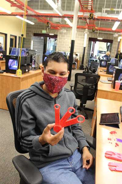 PMG PHOTO: KRISTEN WOHLERS - Student Gonzalo Rodriguez shows off his custom wrench set made using a 3D printer.
