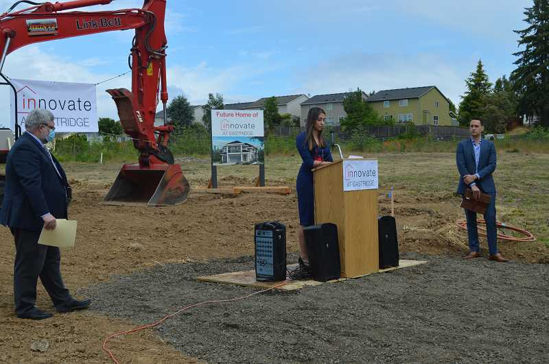 PMG PHOTO: RAY PITZ - Alaina Robertson, center, Taylor Morrison division president, speaks during a groundbreaking ceremony May 20 at River Terrace as Tigard Mayor Jason Snider, left, and Ezra Hammer, land acquisition manager for Taylor Morrison, look on.