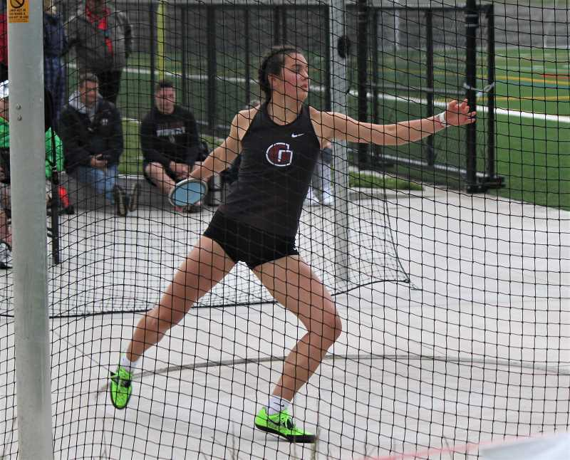 COURTESY PHOTO - Jayda Lee throwing the discus during a meet earlier this past season.