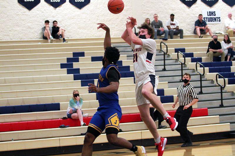 PMG PHOTO: MILES VANCE - Lake Oswego senior Ryan Hooper gets the ball knocked away by Jefferson's Trejon' Williams during the Lakers' 68-57 loss at Lake Oswego High School on Wednesday, May 26.