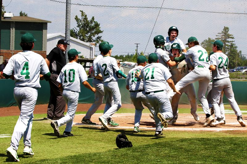 COURTESY PHOTO: JO WHEAT - The North Marion baseball team swarms Gordon Christenson following one of two home runs the senior drove in during the Huskies' 13-6 win over Banks on May 22.
