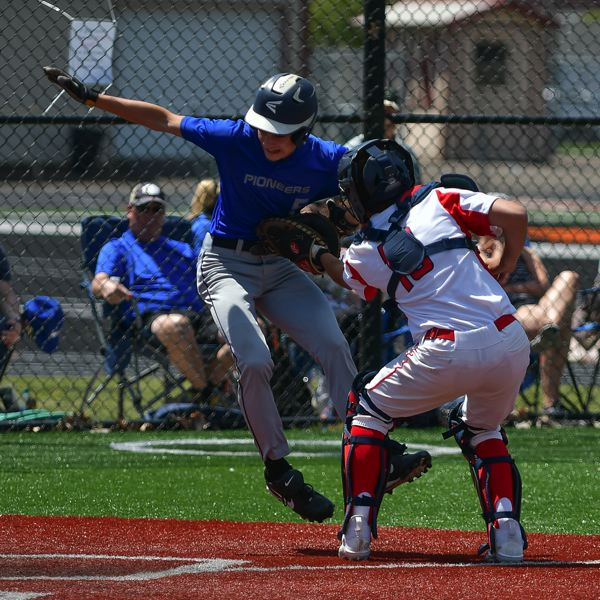 COURTESY PHOTO: ANDRE PANSE - Sophomore catcher Isaac Berning puts the tag on a would-be run in the Trojans' 4-3 win over the Western Christian Pioneers in the semifinal game on May 22.