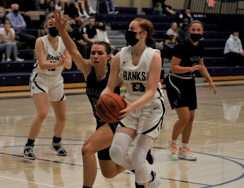 PMG PHOTO: WADE EVANSON - Banks sophomore Hailey Evans drives to the basket during the Braves' game against the Valiants Thursday night, May 27, at Banks High School.