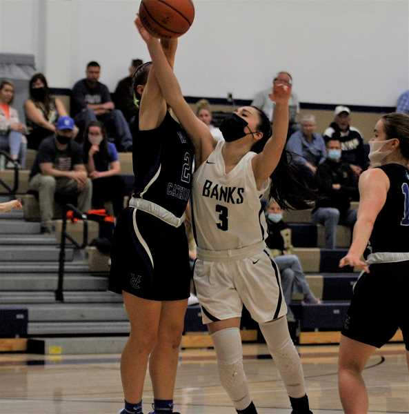 PMG PHOTO: WADE EVANSON - Banks' Camila Narvaez fights for a rebound during the Braves' game against the Valiants Thursday night, May 27, at Banks High School.