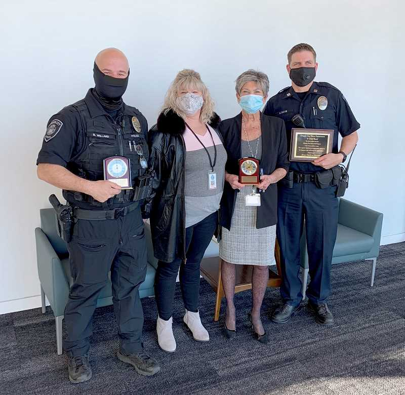 COURTESY PHOTO - Pictured from left are Oregon City Police Officer Brian Willard, OC Driver Ed Program Manager Suz Figini, Municipal Court Judge Laraine McNiece and OCPD Capt. Shaun Davis, accepting an OCPD appreciation award on behalf of OCPD and Chief Jim Band.