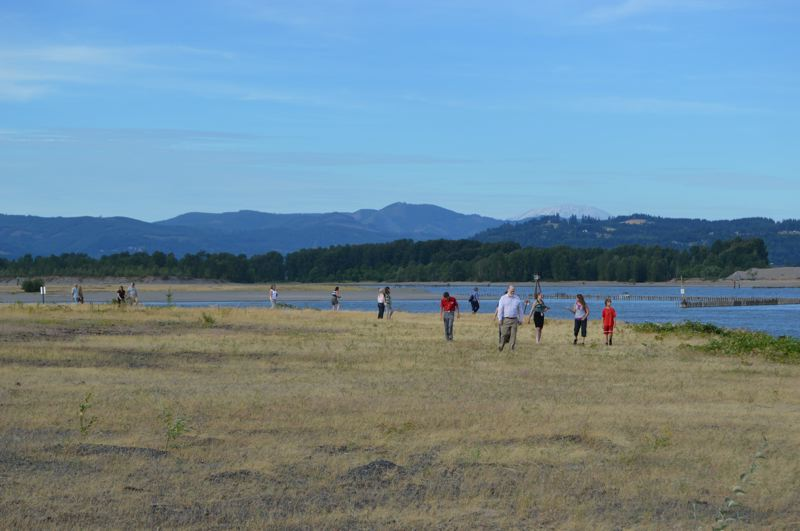 PMG PHOTO: MARK MILLER - People wander along the shoreline of the Columbia River on the Boise Cascade Co. property in St. Helens during a public tour in 2015.