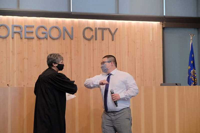 COURTESY PHOTO - Oregon City Municipal Judge Laraine McNiece and newly sworn in Commissioner Adam Marl share a moment after the ceremony on April 30.