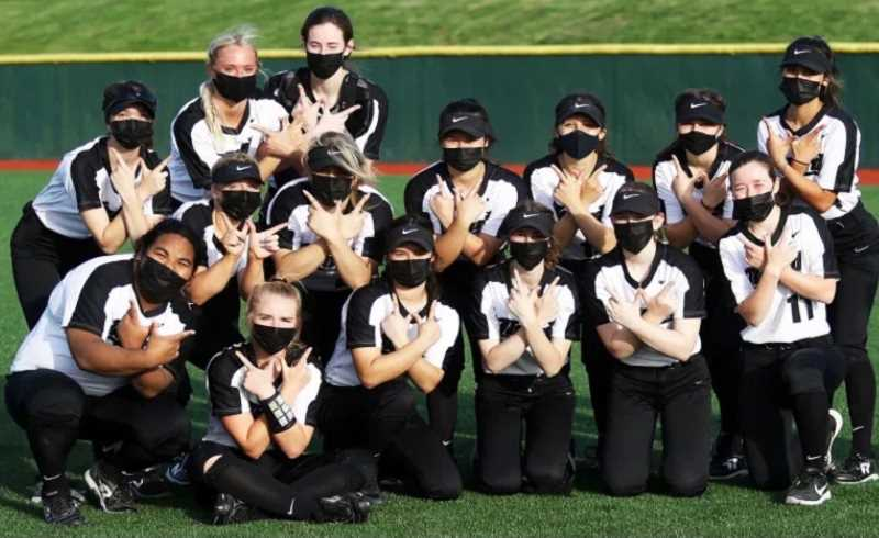 COURTESY PHOTO - The Tigard softball team poses for a team photo. The Tigers finished 16-2 and capped their season with a season-finale win over state-power Jesuit.