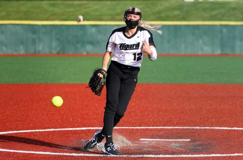 COURTESY PHOTO - Tigard's Makenna Reid hurls a pitch during the 2021 season. Reid threw two no-hitters and 10 shutouts, going 15-2 this season.
