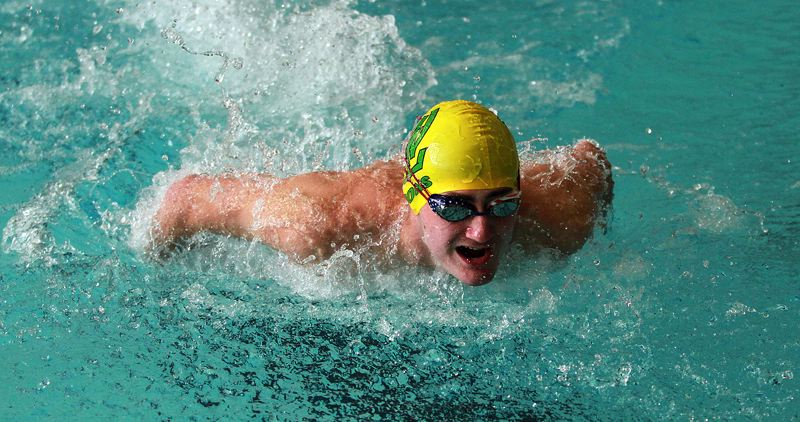 PMG PHOTO: MILES VANCE - West Linn senior Mason Self races through the butterfly leg of his team's win in the 200-yard medley relay against Oregon City at Oregon City Swimming Pool on Thursday, May 26.
