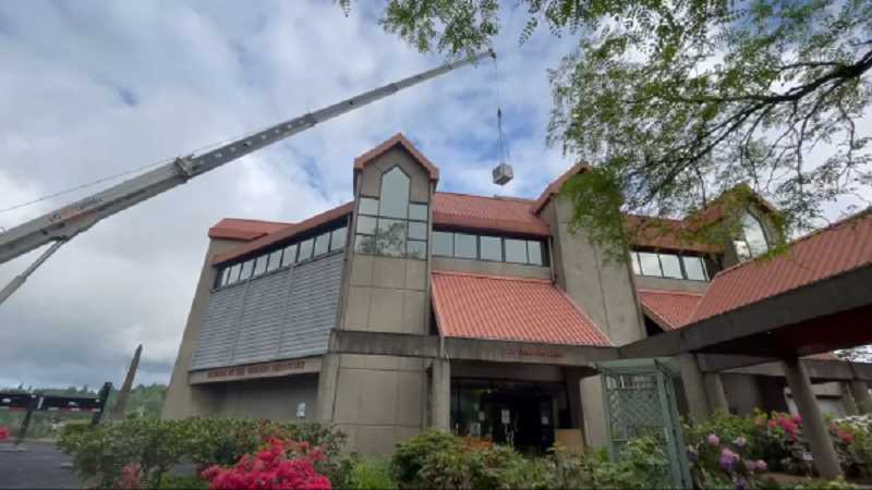 COURTESY PHOTO - A crane aids in installing the new HVAC system on May 4 at Museum of the Oregon Territory.