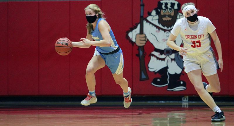 PMG PHOTO: MILES VANCE - Lakeridge junior Reese Ericson speeds upcourt during her team's 52-38 win over Oregon City at Oregon City High School on Friday, May 28.