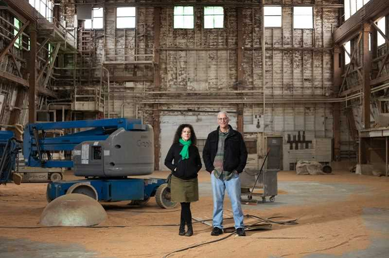 PMG PHOTO: JONATHAN HOUSE - Dana Lynn Louis and Ken Unkeles in the former ship part factory that is now the art space Building 5 in Northwest Prtland.