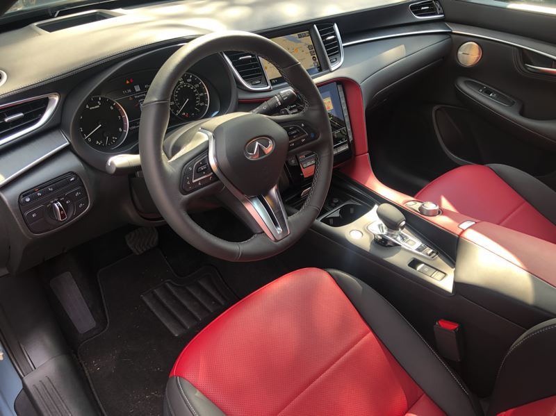PMG PHOTO: JEFF ZURSCHMEIDE - The interior of the 2022 Infiniti QX55 looks more like a high-end sports car than a crossover SUV, which is appropriate.