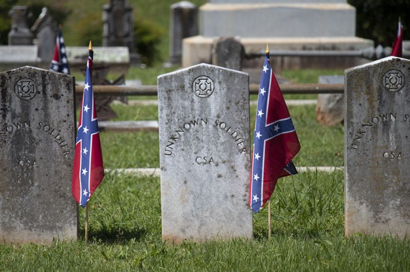 COURTESY PHOTO: DREAMSTIME - Oregon's Commission on Historic Cemeteries recommends that local cemeteries not allow display of the Confederate battle flag on graves of Civil War veterans, like these graves in Athens, Georgia. This is the first Memorial Day since the commission adopted the policy.