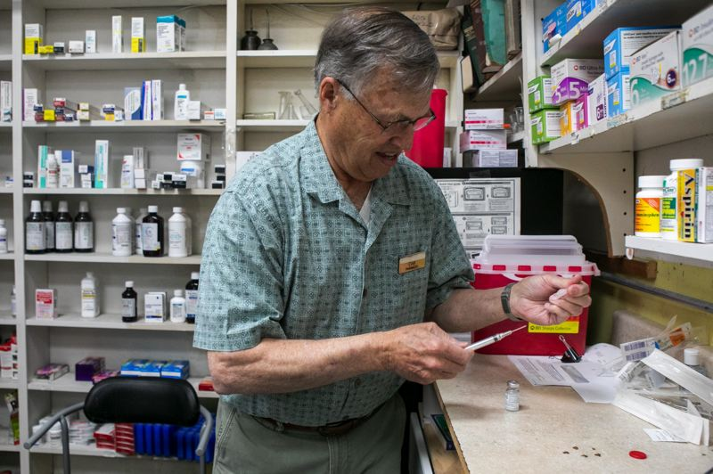 PMG PHOTO: JAIME VALDEZ - Pharmacist Evan Layton came back from retirement to help the Hillsboro Pharmacy and Fountain provide COVID-19 vaccines.
