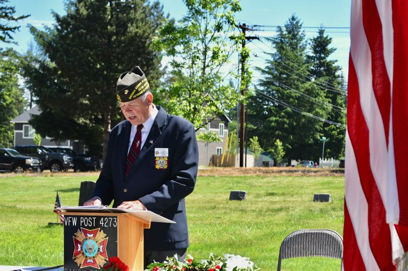 PMG PHOTO: BRITTANY ALLEN - Sandy VFW Post No. 4273 Commander Bert Key addresses a small crowd at Fir Hill Cemetery in Sandy during the post's annual Memorial Day Ceremony.