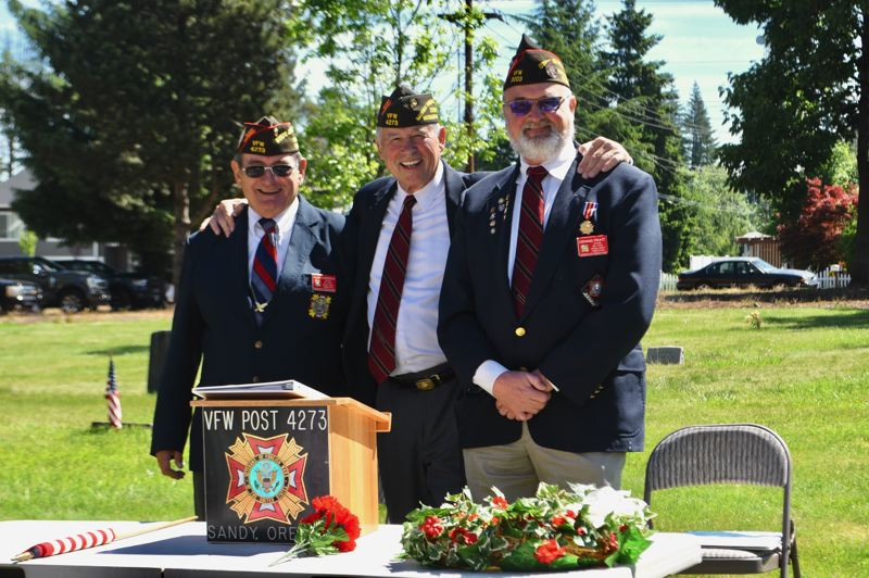 PMG PHOTO: BRITTANY ALLEN - Allen Anderson, Bert Key and Dennis Pratt socialize before the Memorial Day Ceremony at Fir Hill Cemetery begins on Monday, May 31.