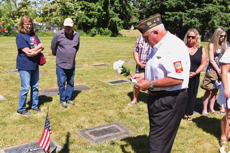 PMG PHOTO: BRITTANY ALLEN - Sandy VFW officers, including Senior Vice Commander Terry Lenchitsky, decorated late Sandy serviceman Alan Gundersons grave in remembrance during the Sandy Memorial Day Ceremony at Fir Hill Cemetery on May 31.