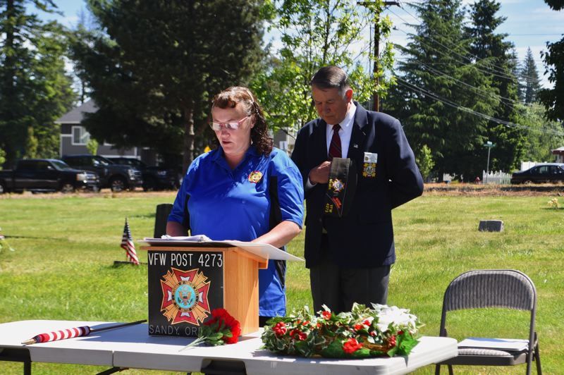 PMG PHOTO: BRITTANY ALLEN - Sandy VFW chaplain April Lindstedt offers a prayer during the Sandy Memorial Day event at Fir Hill Cemetery on May 31.