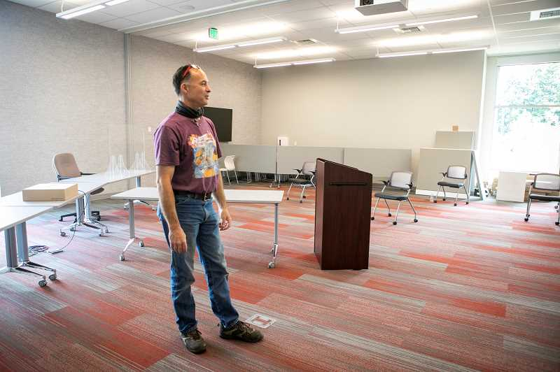 PMG PHOTO: JAIME VALDEZ - Brett Hoffman, a building maintenance technician for the city of Tualatin, stands in the multi-purpose room at Tualatin City Services building where Tualatin Municipal Court is held.