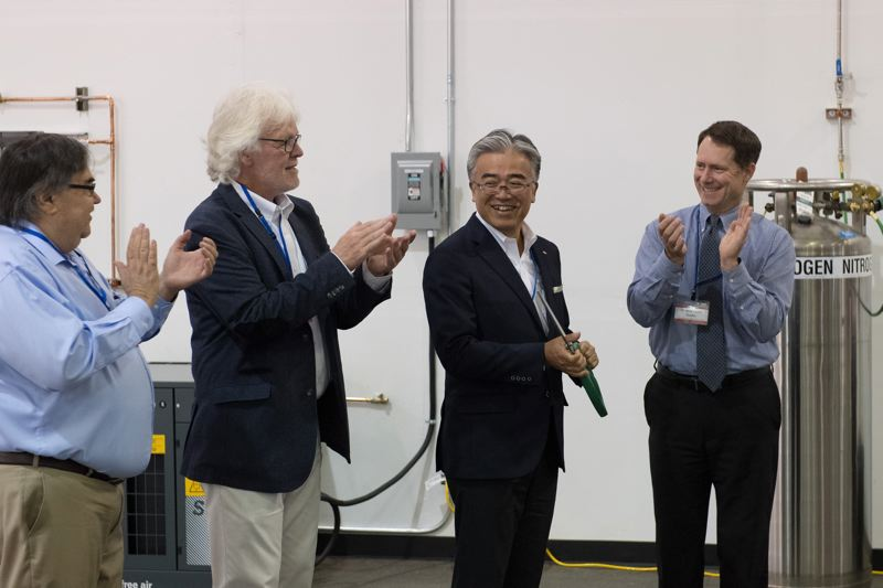 PMG FILE PHOTO - From left, Jeffrey King, Howard Sullivan and Forest Grove City Manager Jesse VanderZanden watch Yamaki Co. President Yoshihiro Kido (second from right) cut the ribbon at Yamaki USA during its 2018 grand opening in Forest Grove.