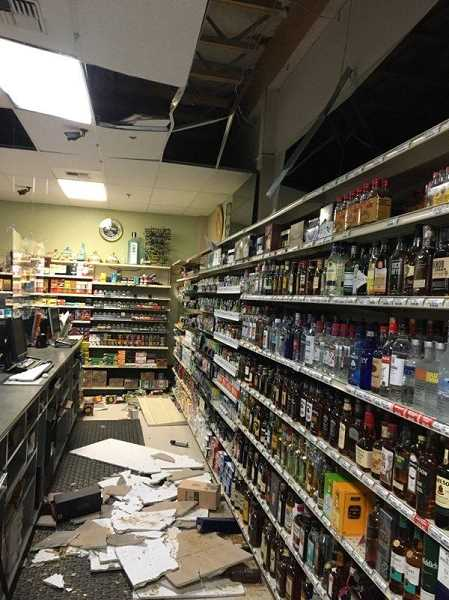 PHOTO CONTRIBUTED BY BOB DICKEY  - The perpetrators created a hole in the roof and came through the ceiling, creating a mess and significant damage to the store.