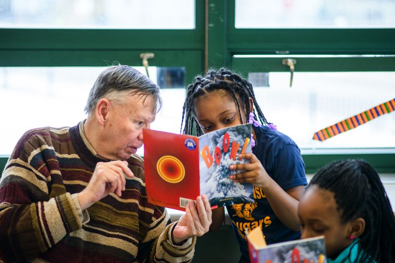COURTESY PHOTO: METROPOLITAN FAMILY SERVICE - Mentors work one-on-one with students to improve reading skills.