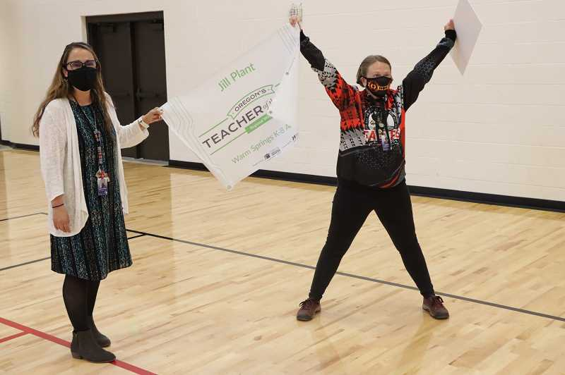 PHOTO COURTESY OF 509-J  - Warm Springs K-8 Academy Principal Bambi Van Dyke helps Plant celebrate her award during a presentation at the school.