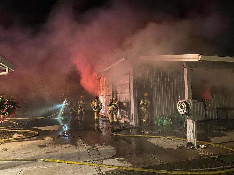 COURTESY PHOTO: FOREST GROVE FIRE & RESCUE - Firefighters attempt to extinguish flames at an outbuilding near Forest Grove early Tuesday morning, June 1.