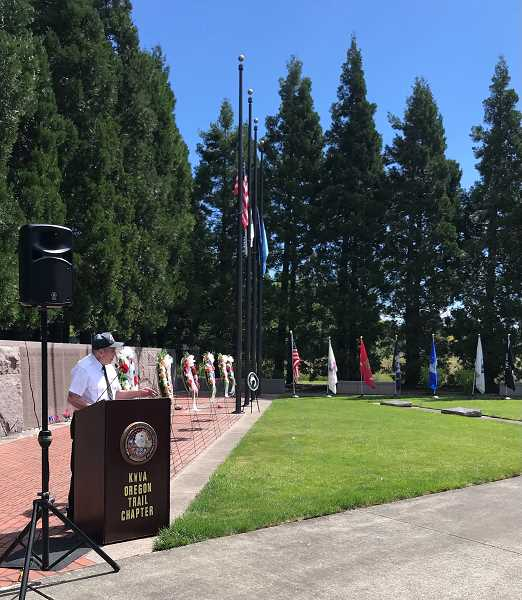COURTESY PHOTO: SY KIM - Chuck Lusardi, president of the Korean War Veterans Association, speaks to the crowd during the Memorial Day celebration at the Korean War Memorial in Wilsonville.