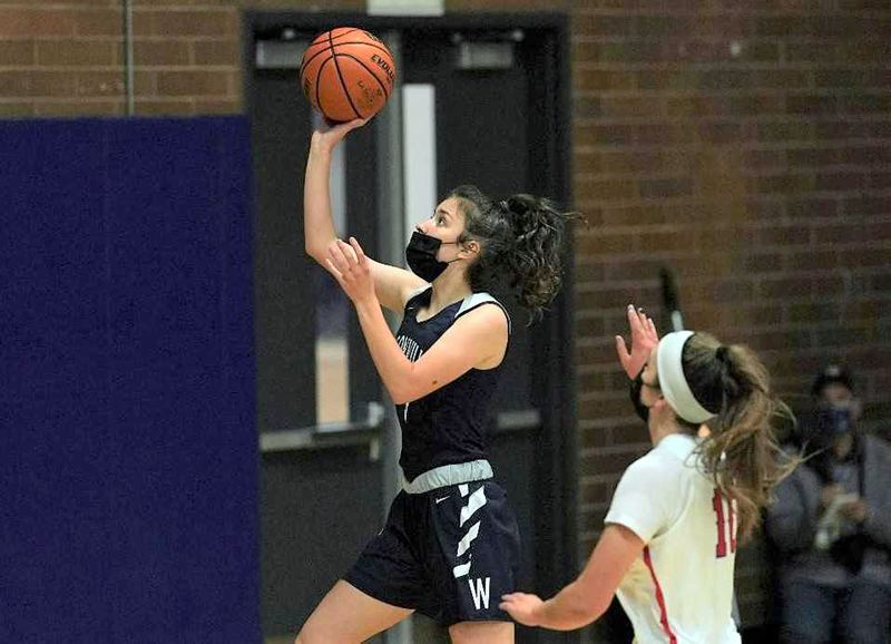 COURTESY PHOTO: JON OLSON - Wilsonville's Karina Borgen goes up for two of her game-high 24 points during her team's Monday, May 31, win at La Salle Prep.