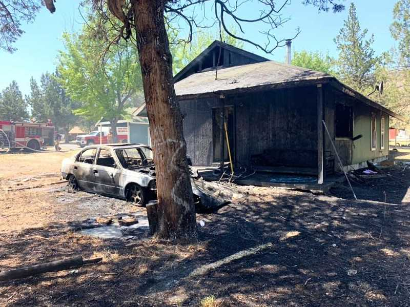 WARM SPRINGS FIRE AND SAFETY PHOTO - Fire damaged a vehicle and single-story duplex on Kalish Road in Warm Springs early Wednesday, June 2.