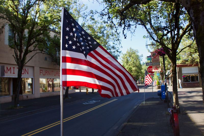PMG PHOTO: CHRISTOPHER KEIZUR - Gresham VFW Post 180 placed flags along Main Avenue in downtown.