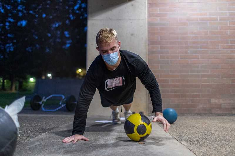 COURTESY PHOTO: CCC - Award-winning photo: A Clackamas Community College wrestler works out in the predawn hours outside at the Oregon City campus during fall term 2020.