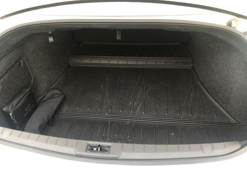 PMG PHOTO: JEFF ZURSCHMEIDE - The trunk in the 2021 Infiniti Q60 is large enough to hold enough luggage for long trips.