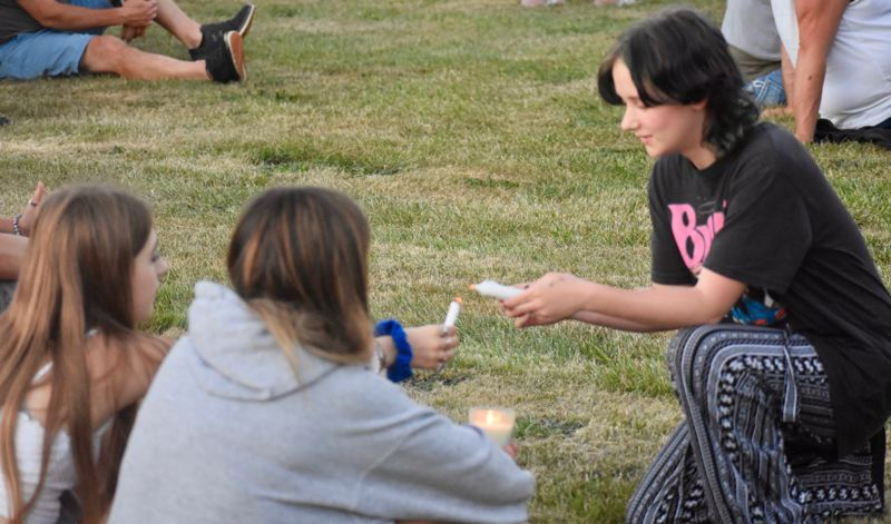 PMG PHOTO: EMILY LINDSTRAND - Estacada students light candles during a vigil in honor of three of their peers on June 2.
