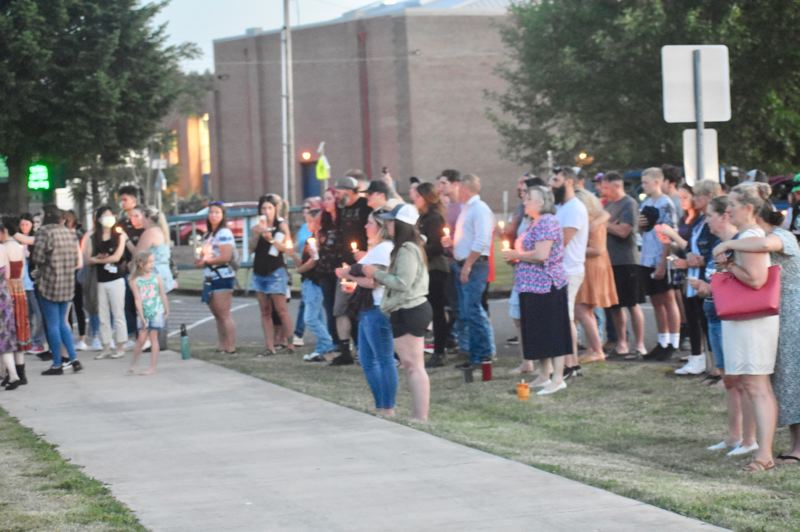 PMG PHOTO: EMILY LINDSTRAND - Estacada community members attend a candlelight vigil in honor of three teenagers who died in a car accident on Memorial Day.