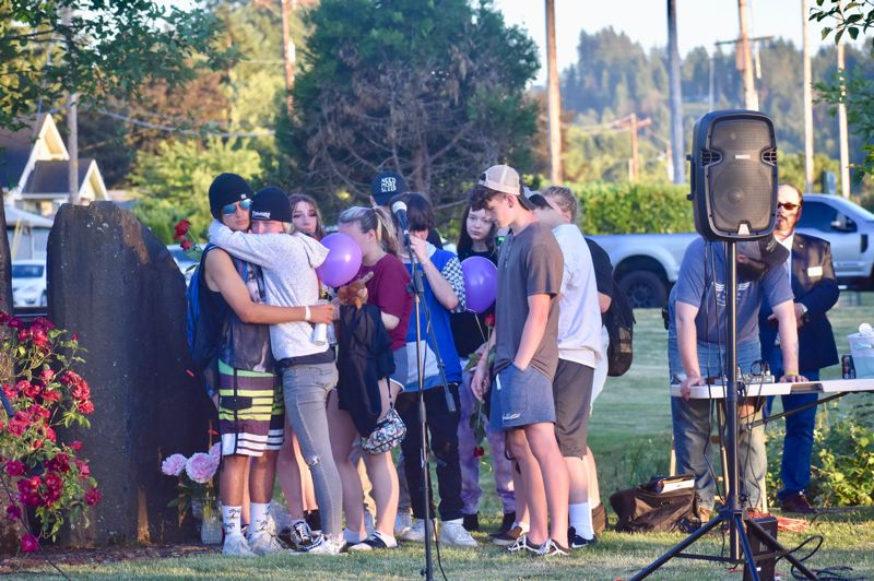 PMG PHOTO: EMILY LINDSTRAND - Estacada students comfort one another during a candelight vigil for three of their peers on June 2.