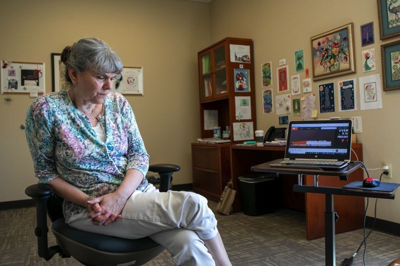 PMG PHOTO: JAIME VALDEZ - Dr. Diane Kaufman listens to a new song she produced called 'Don't Give Up,' which was released in May aims to support people who may consider suicide.