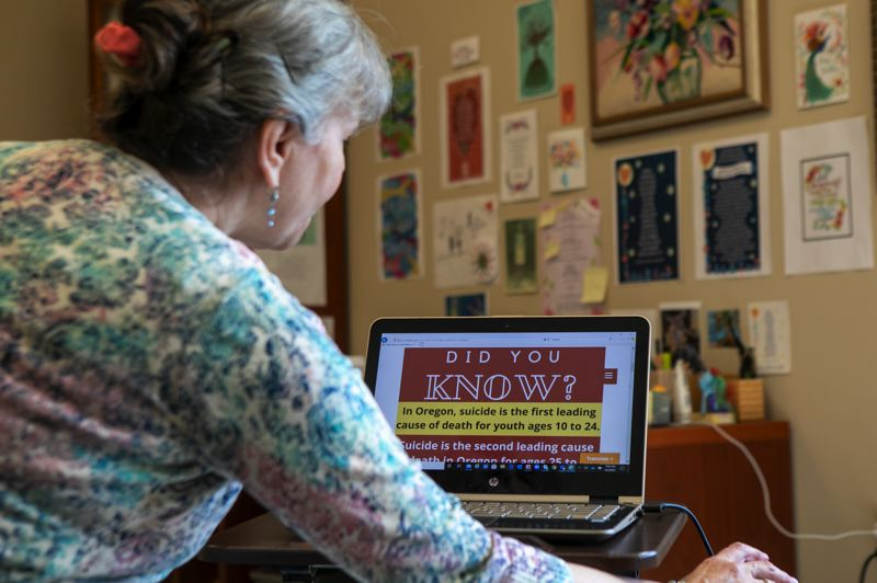 PMG PHOTO: JAIME VALDEZ - Dr. Diane Kaufman scrolls through the website of her new youth mental health campaign, called 'If My Words Could Make A Difference.'