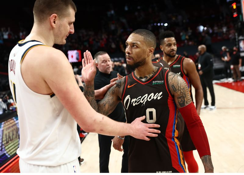 COURTESY PHOTO: BRUCE ELY/TRAIL BLAZERS - Denver's Nikola Jokic and Portland's Damian Lillard greet each other after the Nuggets beat the Blazers on Thursday. Denver won the series, 4-2.