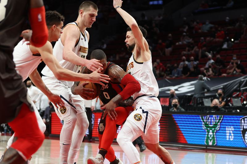 COURTESY PHOTO: BRUCE ELY/TRAIL BLAZERS - The Denver Nuggets were all over Damian Lillard in Thursday's Game 6.