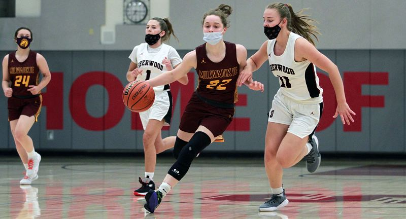 PMG PHOTO: MILES VANCE - Milwaukie junior Cali Denson looks for room to operate during her team's 42-37 loss to Sherwood at Sherwood High School on Thursday, June 3.