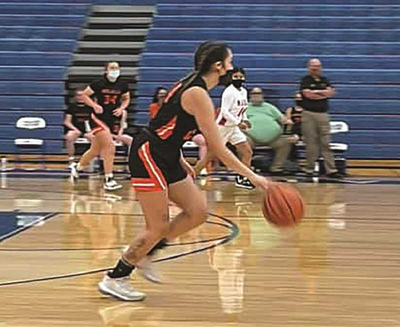 FILE PHOTO - The Molalla girls basketball team used a big third quarter to come back and defeat Estacada on June 3.