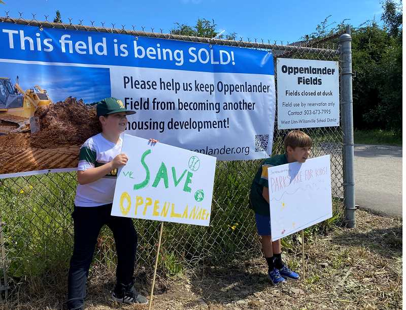 PMG PHOTO - Young West Linn residents attended a rally Saturday, May 28, about saving Oppenlander from development.