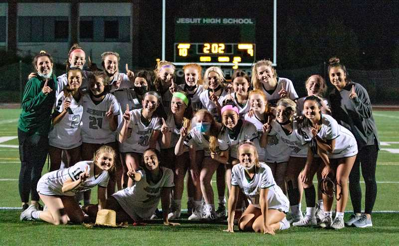 COURTESY PHOTO - The Jesuit girls lacrosse team poses for a photo following their culmination championship win over Lincoln Friday night, May 21, at Jesuit High School. Jesuit players included: (Back row left to right) Coach Lauren blumhardt, Sophie Pittelli, Gigi Remy, Sydney Partovi, Piper Buckley, Amanda Kerr, Mason Young, Jordan Hoffman, Tessa Randall, Lucy Maddocks, Coach Vanessa Swalwell. Second row left to right: Karis Huh, Avery Edwards, Brynn Ensminger, Parker House, Abi Hostler, Sydney Kim, Natalie Kerr, Piper Daskalos, Kiana Santiago. Front row left to right: Eliza Daigle, Ziggy Berkoff, Sydney Landauer.