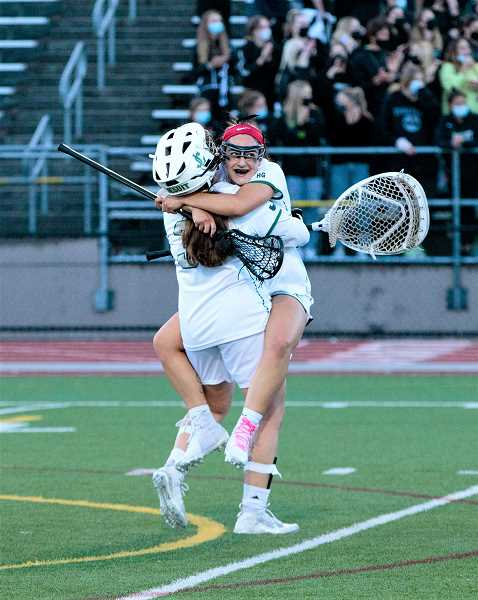 COURTESY PHOTO - Jesuit's Ziggy Berkoff celebrates a goal with teammate Sydney Partovi during the Crusaders' culmination championship game against Lincoln Friday night, May 21, at Jesuit High School.