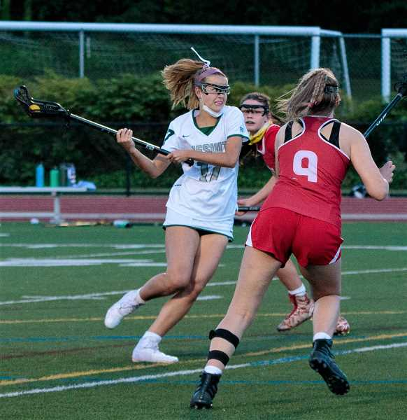 COURTESY PHOTO - Jesuit's Sydney Landauer winds for a shot during the Crusaders' culmination championship game against Lincoln Friday night, May 21, at Jesuit High School.
