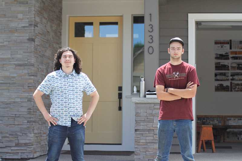 PMG PHOTO: WADE EVANSON - Viking House students Joshua King (left) and Thomas Burford (right) pose for a photo in front of the 2020-21 Viking House in Forest Grove, Thursday, June 3.
